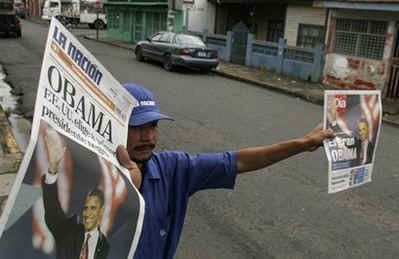 A street vendor with Barack Obama on front pages of newspapers in San Jose Costa Rica.