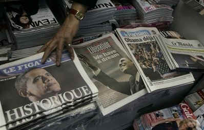 Barack Obama is front page headline news across Europe and the world. A Paris, France newsstand displays the historic newspapers.