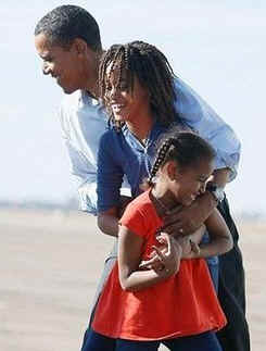 Barack Obama is devoted two his wife Michele and their two daughters Malia and Sasha. Photo: Barack greets his two daughters, Malia, and Sasha, after arriving at Pueblo, Colorado airport on November 1, 2008 during Obama's final Presidential campaign swings.