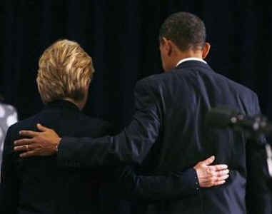 Hillary Clinton and Barack Obama walk away from the podium arm-in-arm after Obama announces National Security Team on December 1st, 2008 in Chicago.