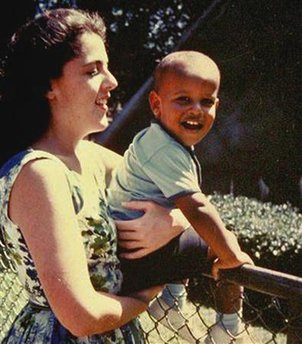 Barack Obama sits on the fence while held by his mother, Ann Dunham in Honolulu. Undated photo is circa 1960s. Anne Dunham was born in Kansas and moved to Hawaii prior to Obama's birth.