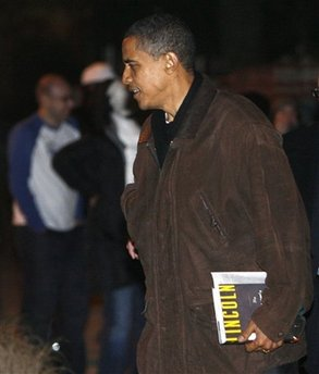 Obama with newly released Lincoln book. President-Elect Obama leaves a friend's house for his motorcade in Chicago on 11/22/08.