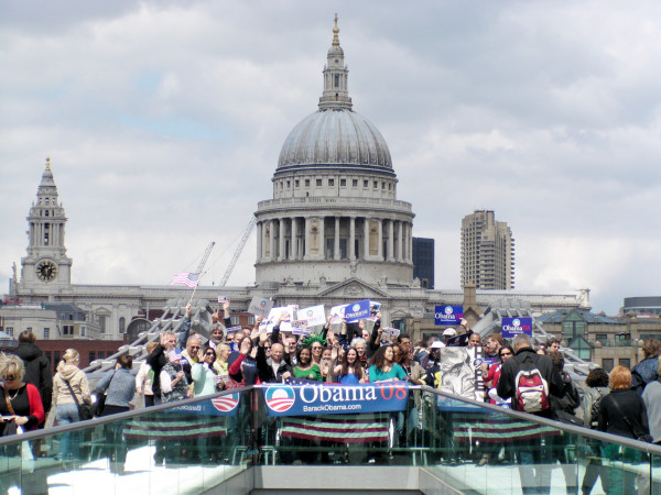 Obama supporters on Millennium Bridge with St. Paul's Cathedral in the background.