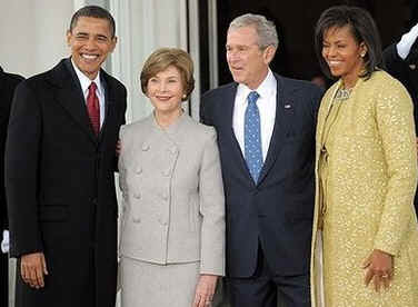 George and Laura Bush meet Michelle and Barack Obama at the North Portico of the White House prior to ceremonies.