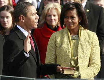 Michelle Obama holds Lincoln Bible from 1861 Inauguration for swearing-in ceremony of President Barack Obama.