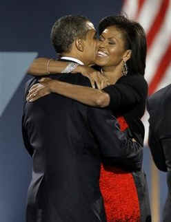 Barack's wife Michelle Robinson Obama was born in Chicago in 1964. Photo: Barack hugs Michelle after his historic November 4, 2008 Presidential victory speech in Hyde Park Chicago.