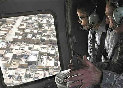 Barack Obama travels by helicopter with General David Petraeus after landing at Baghdad International Airport.
