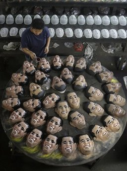 Worker in Rio de Janeiro, Brazil cleans Obama masks on January 16, 2009. The masks are the hottest item for the 2009 Carnival.
