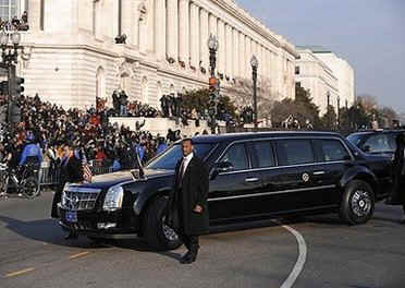 Under heavy security President Obama's high-tech GM Cadillac limousine leads the Inaugural Parade from the Capitol Building to the White House.