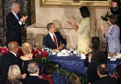 President Barack Obama is introduced by First Lady Michelle Obama at the Inaugural Luncheon at Statuary Hall at the US Capitol. The first course of the Inauguration Luncheon is be served on replicas of Lincoln china selected by Lincoln's wife Mary Todd Lincoln.