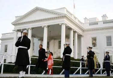 The presidential family arrives at the reviewing stand in front of the White House to watch the Inaugural Parade.