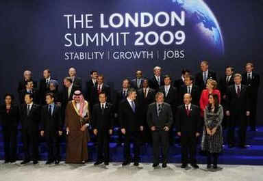 President Barack Obama and the G20 leaders return to the stage for a second G20 group photo after Canadian Prime Minister Stephen Harper was missing from the first group photo.