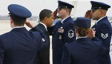 President Barack Obama is saluted by officers at Andrews Air Force Base in Maryland before boarding a flight on Air Force One to Fort Meyers, Florida for a town hall style meeting to discuss Obama's economic stimulus plan.