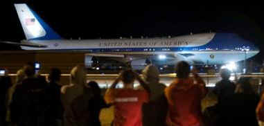 Air Force One with President Barack Obama aboard taxis at Abraham Lincoln Capital Airport in Springfield, Illinois while onlookers snap photos.