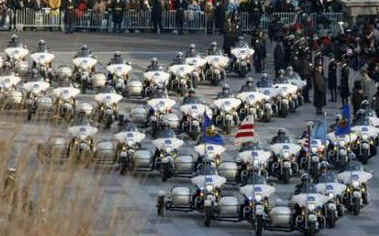 A Police Motorcycle Escort Group rumbles down the parade route as the Inaugural Parade proceeds to the White House.