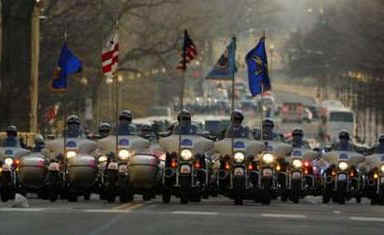 A Police Motorcycle Escort Group rumbles down Pennsylvania Avenue as the Inaugural Parade proceeds to the White House.