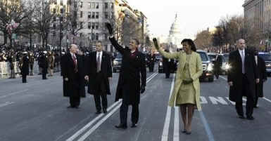 Secret Service agents stay close to the President and the First Lady on their walk down Pennsylvania Avenue.
