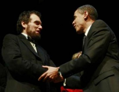 President Barack Obama and First Lady Michelle Obama attend the Grand Re-Opening of Ford's Theatre in Washington on February 11, 2009. President Obama meets a Lincoln actor (photo), receives a copy of the Gettysburg Address, and speaks just below the box where President Abraham Lincoln was shot.