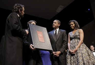 President Barack Obama and First Lady Michelle Obama attend the Grand Re-Opening of Ford's Theatre in Washington on February 11, 2009. President Obama meets a Lincoln actor, receives a copy of the Gettysburg Address (photo), and speaks just below the box where President Abraham Lincoln was shot.