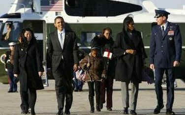 The Obama family arrives at Andrews Air Force Base for a trip on Air Force One to Chicago. The Obama family is returning to Obama's Chicago home for the President's Day weekend.