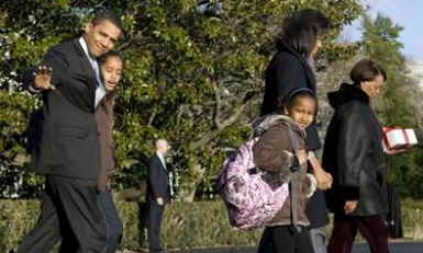 President Barack Obama and his family walk across the South Lawn of the White House to Marine One.