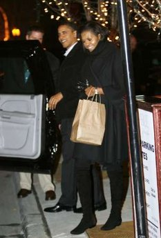 President Barack Obama and First Lady Michelle Obama leave Table 52 restaurant after a Valentine's Day dinner in Chicago.