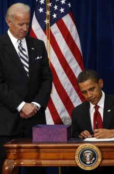 President Barack Obama signs the $787 billion American Recovery and Investment Plan into law at the Denver Museum of Nature and Science.