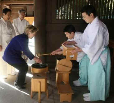 Secretary of State Hillary Clinton visits the Meiji Shrine in Tokyo. Temple priests guide Clinton through the shrine and prepare her for prayers and a sacred tree branch offering on February 17, 2009.