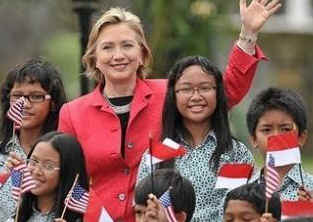 Secretary of State Hillary Clinton arrives in Jakarta, Indonesia and is greeted by elementary students from President Barack Obama's former Indonesian school when he lived in Jakarta with his mother in the early 1970s.
