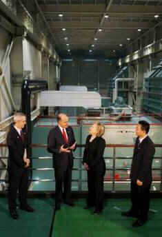 Secretary of State Hillary Clinton tours a Geothermal power plant in Beijing with senior GE Chine officials, and meets with plant employees.