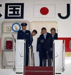 Japan's PM Taro Aso arrives at Andrews Air Force Base on February 23, 2009.