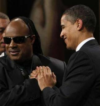 First Lady Michelle Obama hosts a function for musician Stevie Wonder who was awarded the Library of Congress Gershwin Prize in a ceremony in the East Room of the White House on February 25, 2009.