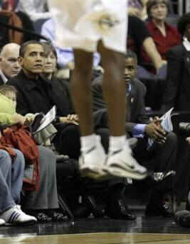 President Obama and his friend Marty Nesbitt watch the NBA match between the Washington Wizards and the Chicago Bulls at the Verizon Center in Washington. Obama is a Bulls fan, however the Wizards won the game 113-90.
