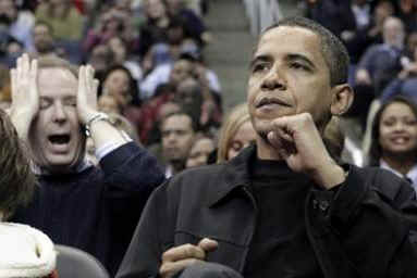 Obama reacts to Chicago basket. President Obama and his friend Marty Nesbitt watch the NBA match between the Washington Wizards and the Chicago Bulls at the Verizon Center in Washington. Obama is a Bulls fan, however the Wizards won the game 113-90.