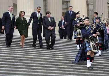 President Barack Obama leaves the Capitol Building after a St. Patrick's Day luncheon with Ireland's Prime Minister Brian Cowen. President Obama. led by a bagpiper, walks down the Capitol Hill stairs with PM Brian Cowen, and Speaker of the House Nancy Pelosi.