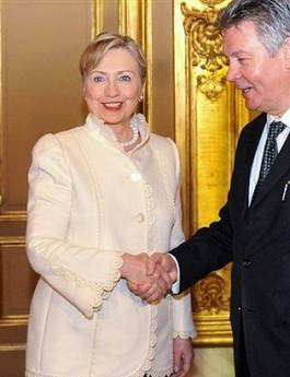 Secretary of State Hillary Clinton arrives in Brussels for dinner at the Egmont Palace with NATO and European Union foreign ministers. Clinton is greeted by Belgium Foreign Minister Gucht.