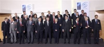 Secretary of State Hillary Clinton in Brussels for round table meetings with NATO foreign ministers (group photo).