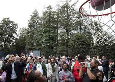 President Barack Obama took some time away from the traditional White House Easter Egg Roll to throw a few basketball hoops with the Easter Monday crowd on the White House grounds on April 13, 2009.