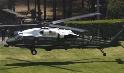President Obama is transported to Campo de Mart Military Field via Marine One to join Mexican President Calderon.