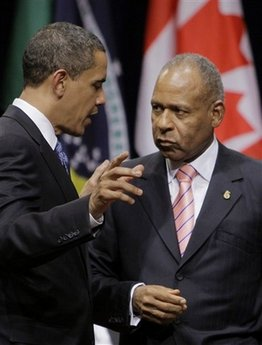 President Obama talks to the Prime Minister of Trinidad and Tobago Patrick Manning