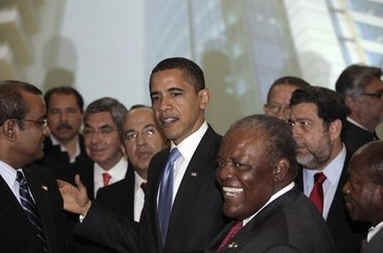 President Barack Obama greets other summit leaders prior to the official photo of the Heads of State.