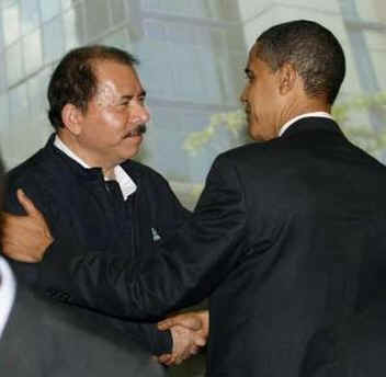 President Barack Obama greets Nicaragua's President Ortega and other summit leaders prior to the official photo of the Heads of State.