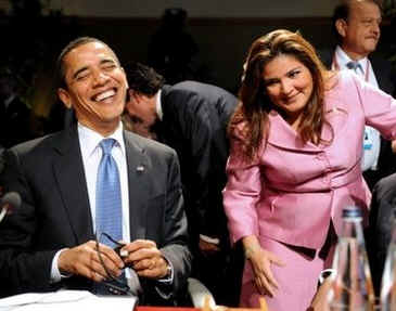 President Barack Obama laughs with El Salvador's Foreign Minister Arguetta at the First Plenary Session of the 5th Summit of the Americas.