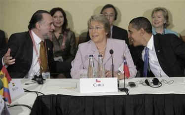 President Barack Obama attends the UNASR countries meeting on April 18, 2009 in Port of Spain, Trinidad and Tobago. Obama sits next to Chilean President Bachelet.
