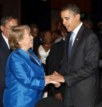 President Obama played the gentleman and assisted Chile's President Bachelet to her seat.