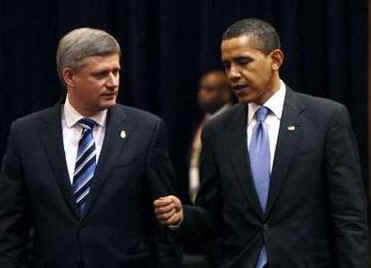 President Barack Obama arrives with Canadian Prime Minister Stephen Harper on the second day of the 5th Summit.