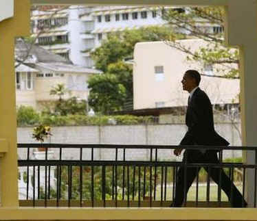 President Obama on his way to a news conference on the rooftop of his hotel in Port of Spain, Trinidad and Tobago on April 19, 2009.
