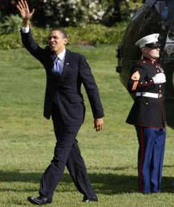 President Obama waves after Marine One arrives on the South Lawn of the White House on April 22, 2009.