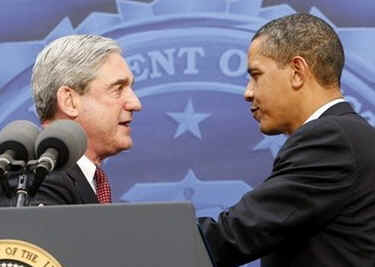 President Obama is introduced by FBI Director Robert Mueller who gives Obama an FBI cap and two teddy bears for daughters Sasha and Malia.