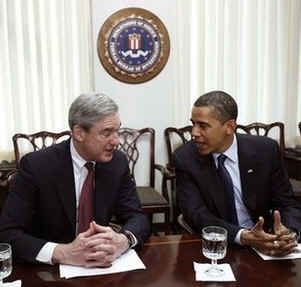 President Barack Obama meets with FBI Director Robert Mueller at FBI Headquarters in Washington on April 28, 2009.